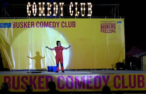 Ernest on the Busker Comedy Club stage at the World Buskers Festival